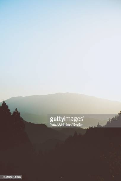 scenic view of silhouette mountains against clear sky - 奈良市 ストックフォトと画像