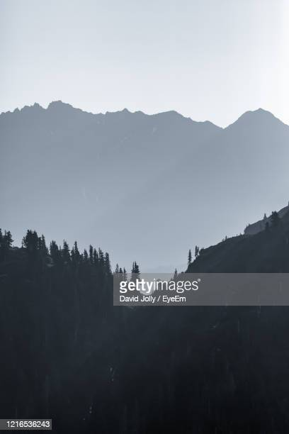 scenic view of silhouette mountains against clear sky - bellingham stock pictures, royalty-free photos & images