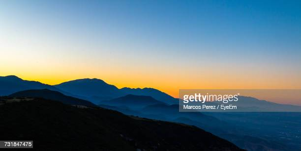 scenic view of silhouette mountains against clear sky - サンバーナーディーノ市 ストックフォトと画像