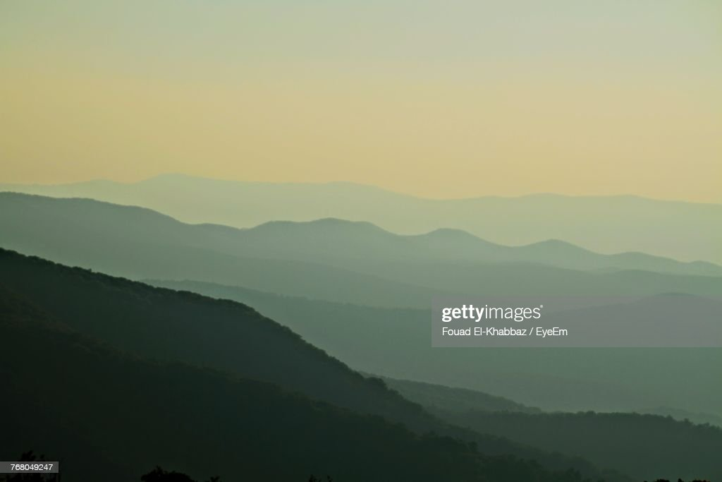 Scenic View Of Silhouette Mountains Against Clear Sky : Stock Photo