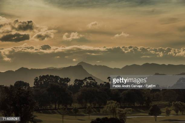scenic view of silhouette mountains against dramatic sky - carvajal stock photos and pictures