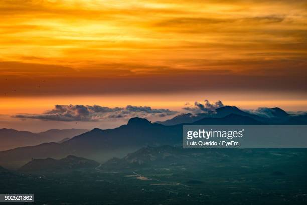 scenic view of silhouette mountains against orange sky - angola stock pictures, royalty-free photos & images