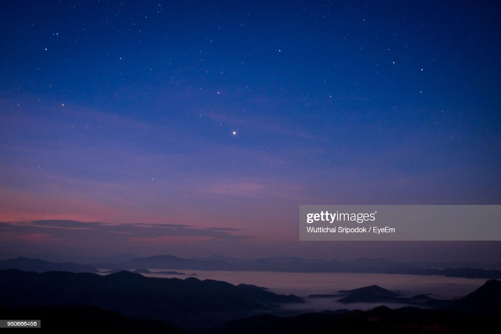 Scenic View Of Silhouette Mountains Against Sky At Night : Stock Photo