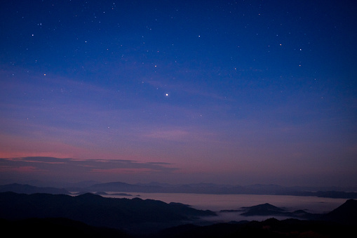 Scenic View Of Silhouette Mountains Against Sky At Night - gettyimageskorea