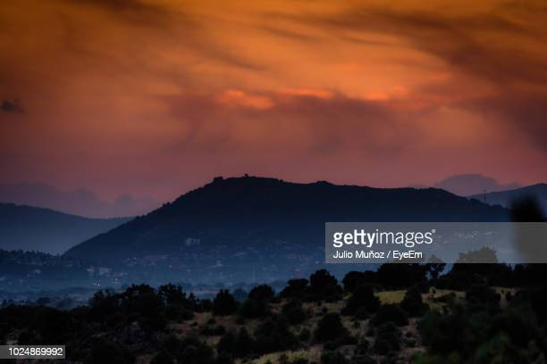 scenic view of silhouette mountains against sky at sunset - pinaceae stock pictures, royalty-free photos & images