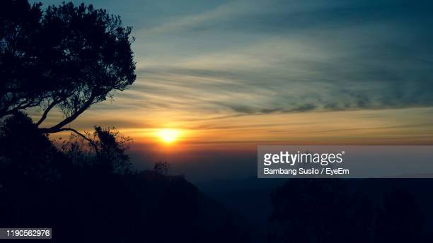 scenic view of silhouette mountains against sky at sunset - tengger stock pictures, royalty-free photos & images