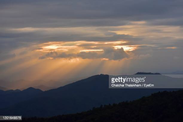 scenic view of silhouette mountains against sky at sunset - chatchai thalaikham stock pictures, royalty-free photos & images
