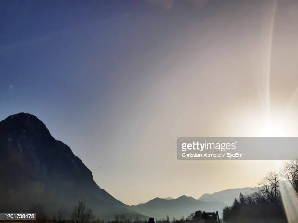scenic view of silhouette mountains against sky at sunset - principality of liechtenstein stock pictures, royalty-free photos & images