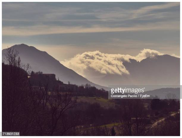 scenic view of silhouette mountains against sky at sunset - costangelo pacilio foto e immagini stock