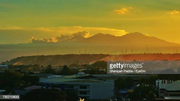 scenic view of silhouette mountains against sky at sunset - davao city fotografías e imágenes de stock