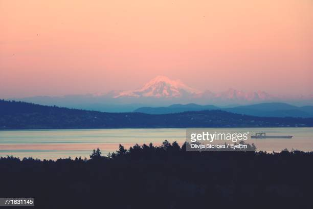 scenic view of silhouette mountains against sky at sunset - victoria canada stock pictures, royalty-free photos & images