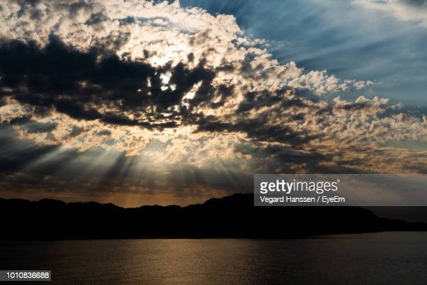 scenic view of silhouette mountains against sky during sunset - vegard hanssen stock pictures, royalty-free photos & images