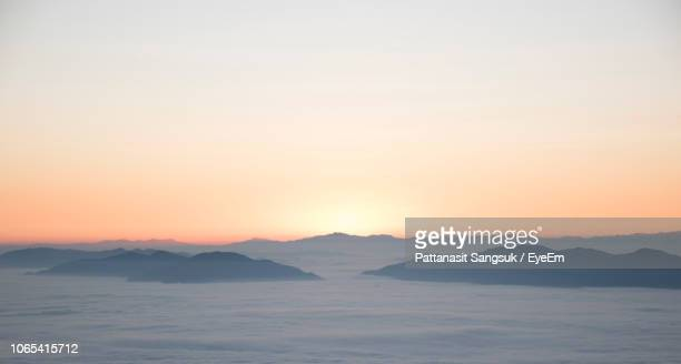 scenic view of silhouette mountains against sky during sunset - pattanasit stock pictures, royalty-free photos & images
