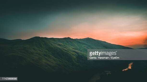 Scenic View Of Silhouette Mountains Against Sky During Sunset