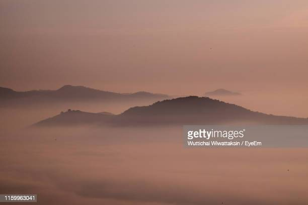 scenic view of silhouette mountains against sky during sunset - hat yai foto e immagini stock
