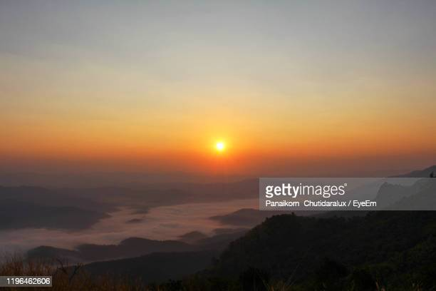 scenic view of silhouette mountains against sky during sunset - panaikorn chutidaralux stock photos and pictures