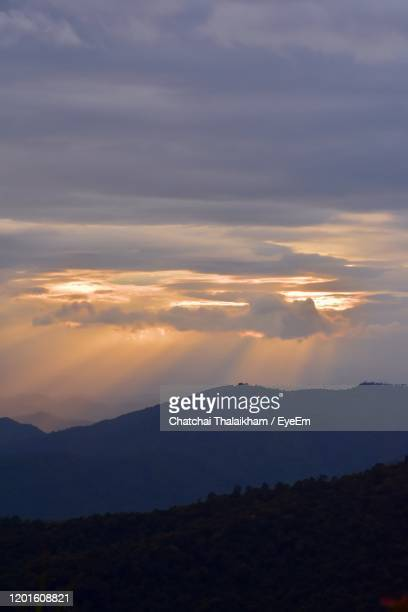 scenic view of silhouette mountains against sky during sunset - chatchai thalaikham stock pictures, royalty-free photos & images