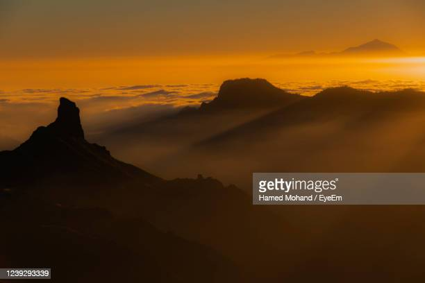 scenic view of silhouette mountains against sky during sunset - tejeda canary islands stock pictures, royalty-free photos & images