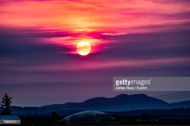 scenic view of silhouette mountains against sky during sunset - ashley ross stock pictures, royalty-free photos & images