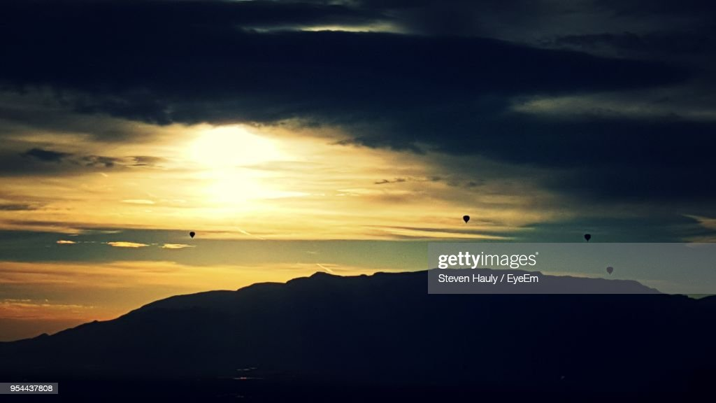 Scenic View Of Silhouette Mountains Against Sky During Sunset : Stock Photo