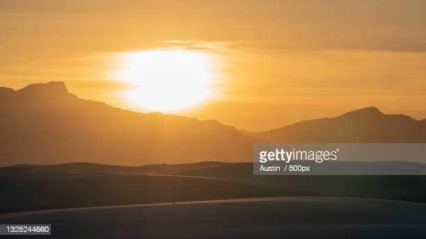scenic view of silhouette mountains against sky during sunset,white sands national park,new mexico,united states,usa - discovery stock pictures, royalty-free photos & images