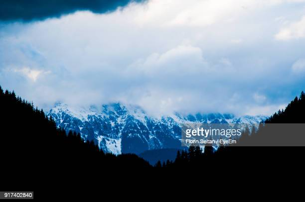 Scenic View Of Silhouette Mountains Against Sky During Winter