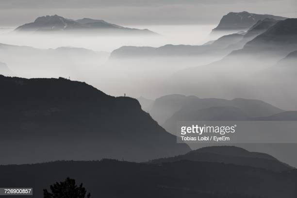 scenic view of silhouette mountains against sky - loibl stock-fotos und bilder