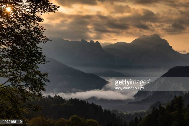 scenic view of silhouette of mountains against sky at sunset,unken,austria - andy dauer stock pictures, royalty-free photos & images