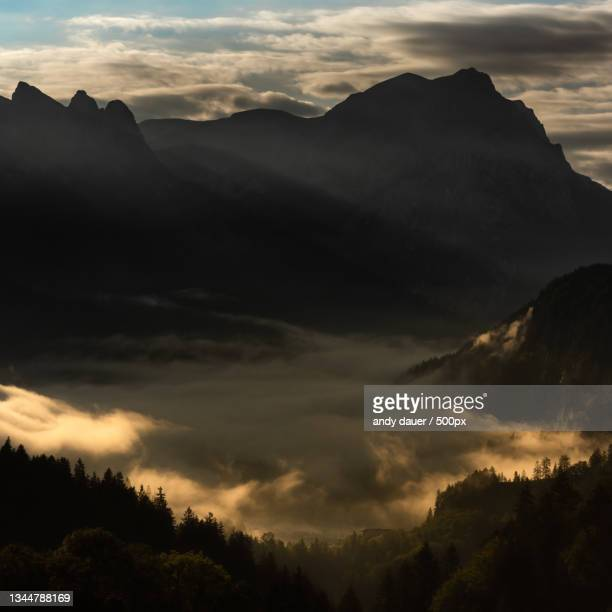 scenic view of silhouette of mountains against sky at sunset - andy dauer stock pictures, royalty-free photos & images