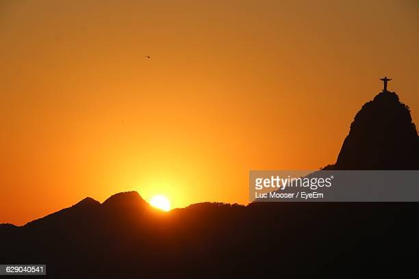 Scenic View Of Silhouette Sugarloaf Mountain Against Sky During Sunset