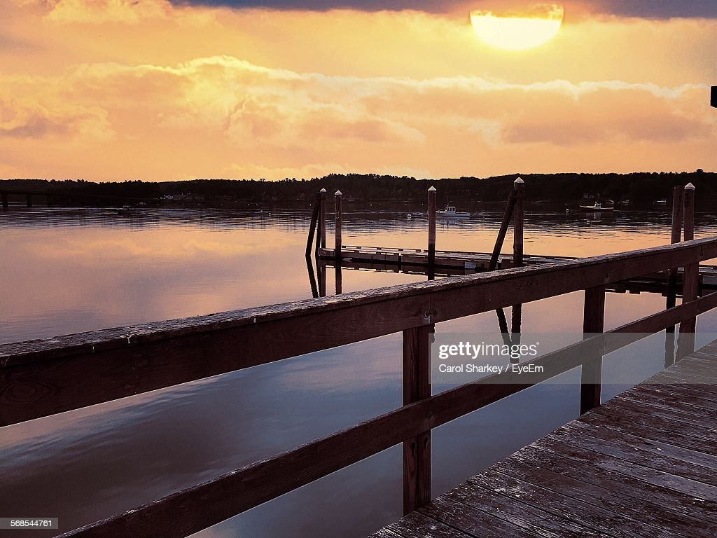 Scenic View Of Sky And River From Bridge During Sunset : Stock Photo