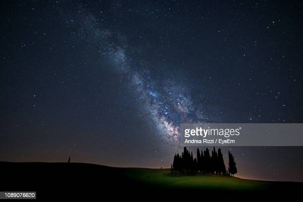scenic view of sky at night - andrea rizzi stockfoto's en -beelden