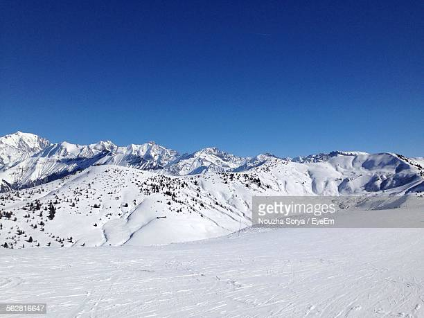 Scenic View Of Snow Capped Mountain Against Clear Sky