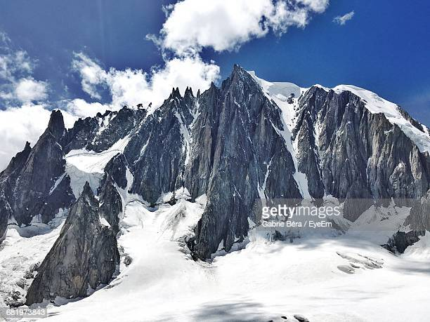 scenic view of snow covered aiguille du midi against sky - aiguille de midi stock photos and pictures