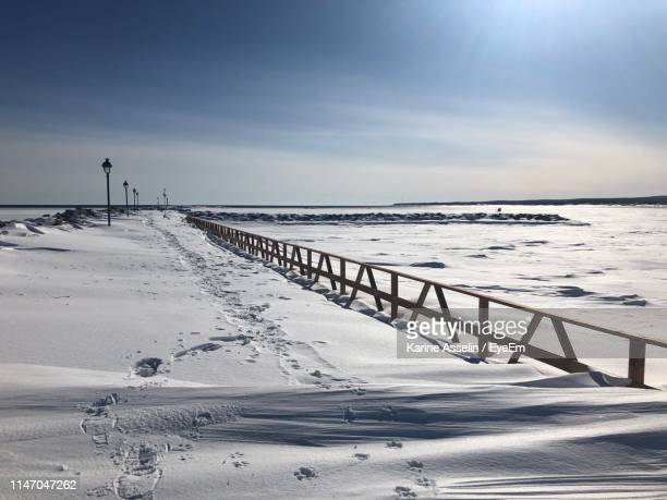 Scenic View Of Snow Covered Beach Against Sky