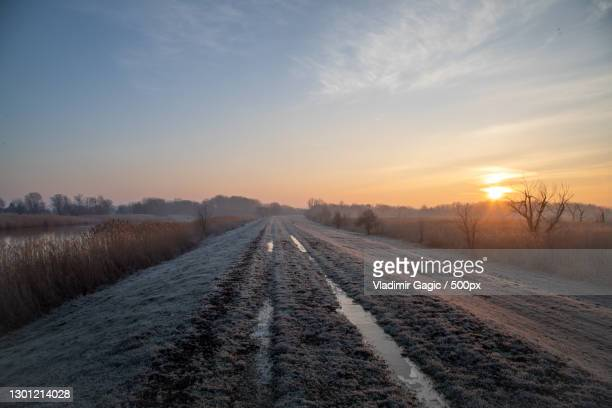 scenic view of snow covered field against sky during sunset,serbia - serbia stock pictures, royalty-free photos & images