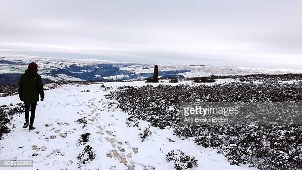 scenic view of snow covered field against sky - mytholmroyd stock pictures, royalty-free photos & images