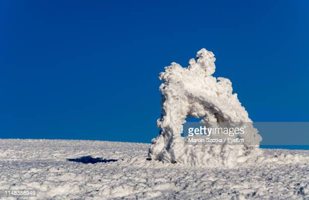scenic view of snow covered land against clear blue sky - babia góra mountain stock pictures, royalty-free photos & images