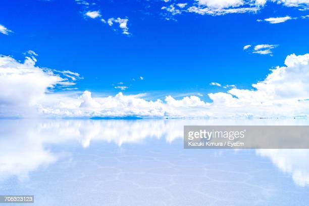 scenic view of snow covered landscape against blue sky - ウユニ塩湖 ストックフォトと画像