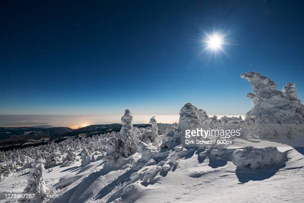 scenic view of snow covered landscape against sky at night - nacht stock pictures, royalty-free photos & images