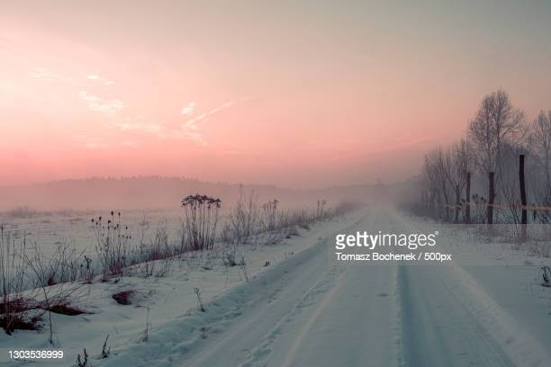 scenic view of snow covered landscape against sky during sunset - images stock pictures, royalty-free photos & images