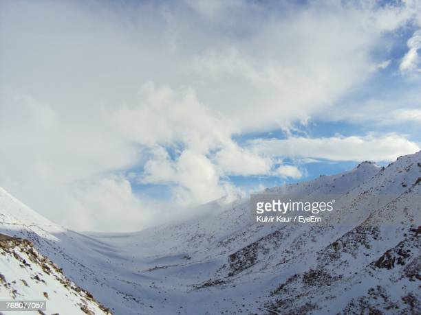 Scenic View Of Snow Covered Landscape Against Sky