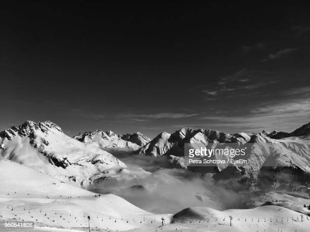 scenic view of snow covered landscape against sky - lech stock pictures, royalty-free photos & images