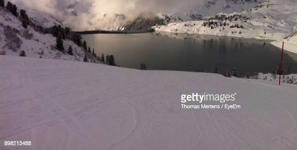 scenic view of snow covered landscape - mertens stock pictures, royalty-free photos & images