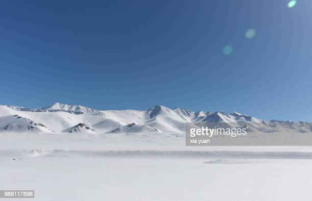 scenic view of snow covered mountain against clear blue sky - tundra stock pictures, royalty-free photos & images