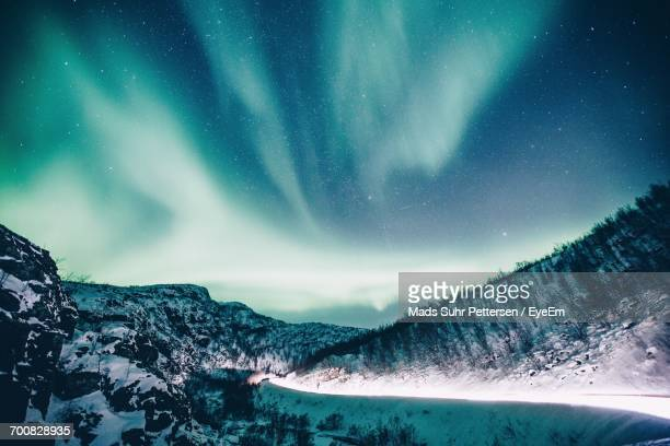 Scenic View Of Snow Covered Mountain Against Sky At Night