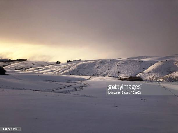 scenic view of snow covered mountain against sky - lorraine smothers stock pictures, royalty-free photos & images