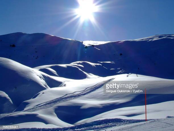 scenic view of snow covered mountain against sky - アロサ ストックフォトと画像