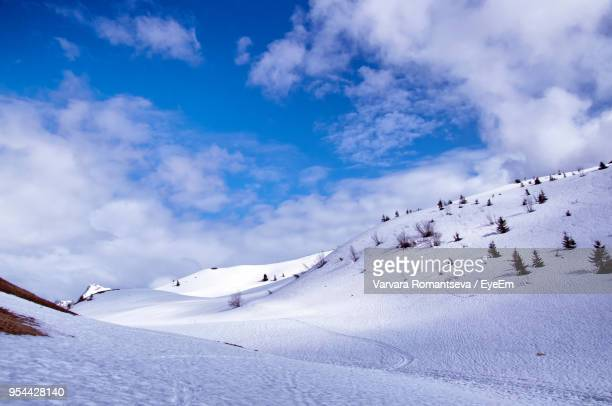 scenic view of snow covered mountain against sky - le grand bornand stock pictures, royalty-free photos & images