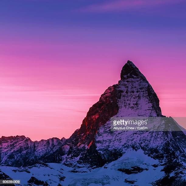 Scenic View Of Snow Covered Mountain During Sunset